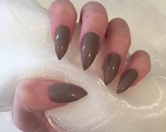 Burgundy matte stiletto nails with rhinestone by