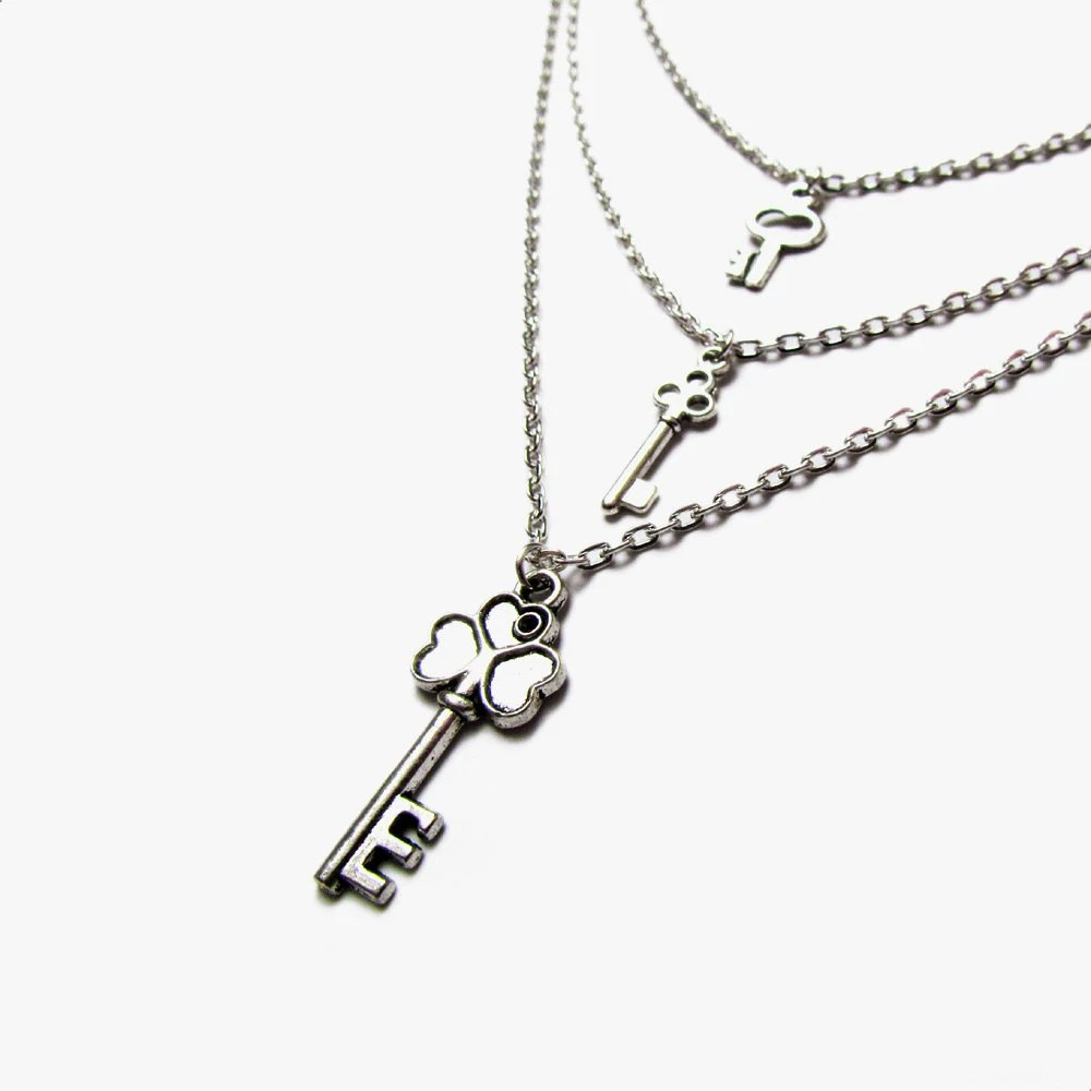 Items similar to Silver skeleton keys layered necklace