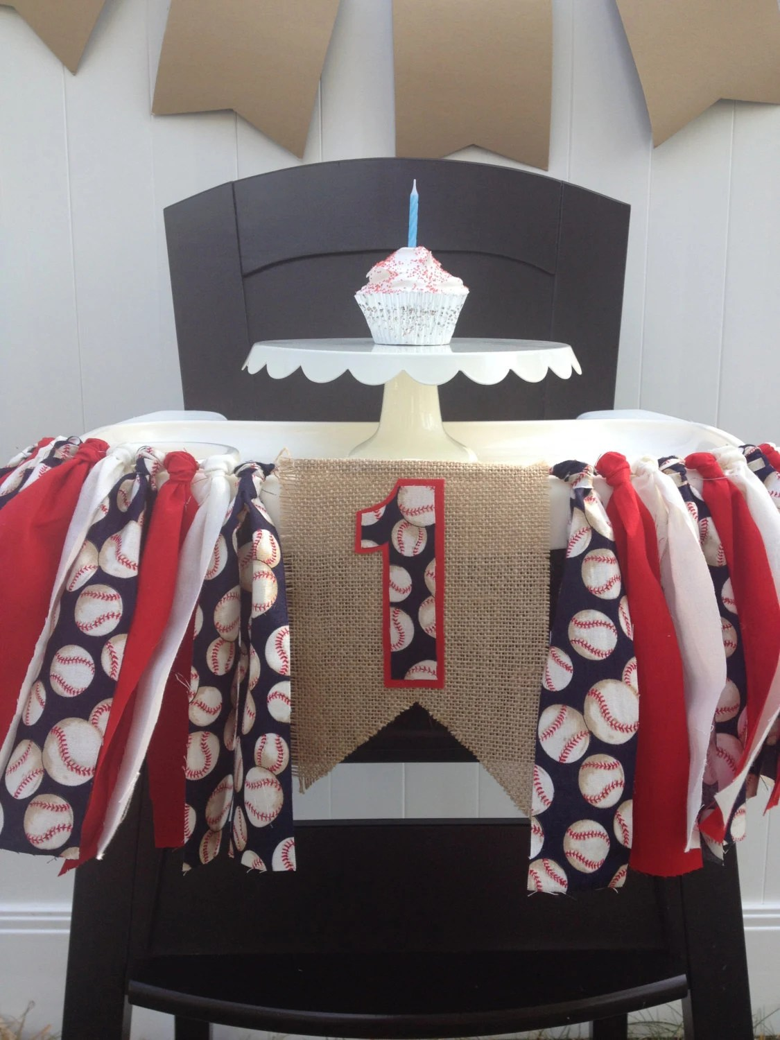 first high chair invented pride lift remote replacement baseball birthday highchair banner boys