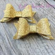 set of 2 layered glitter bows gold