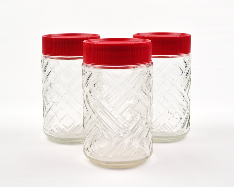 set of 3 decorative glass storage jars with red plastic. Black Bedroom Furniture Sets. Home Design Ideas