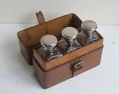 Cased bottle set, antique...