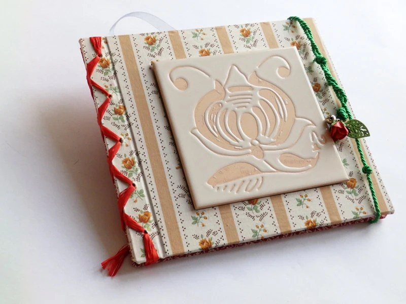Guest blank book with textile covers and handmade tile on the front cover