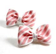 white hair bows with peach stripes