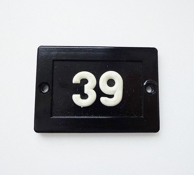 Apartment door number 39 thirtynine black small plastic