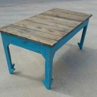 Boho style reclaimed wood coffee table with split arrow legs