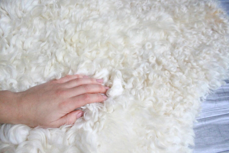 sheepskin rug on chair hollywood regency bamboo chairs sale genuine gotland breed pelt