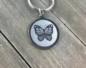 Butterfly dog tag • But...