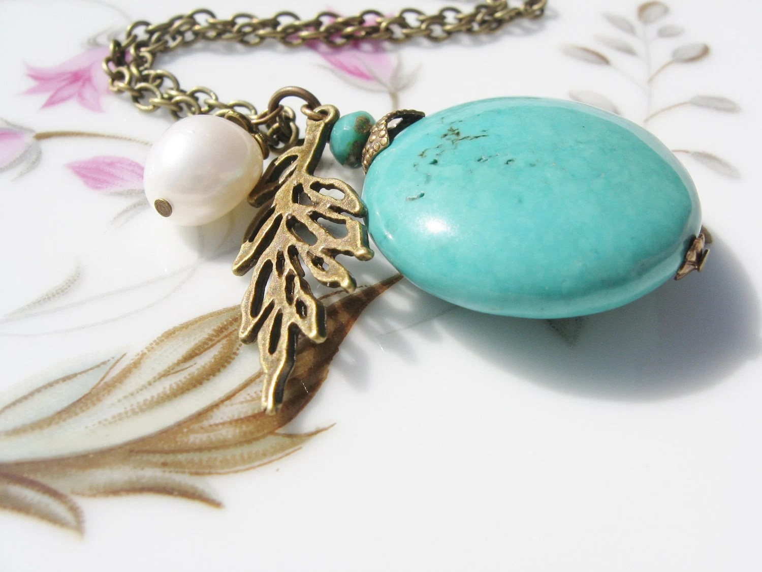 Turquoise Charm Necklace - Blue Magnesite Stone, Leaf Charm, Freshwater Pearl, Antiqued Brass Chain