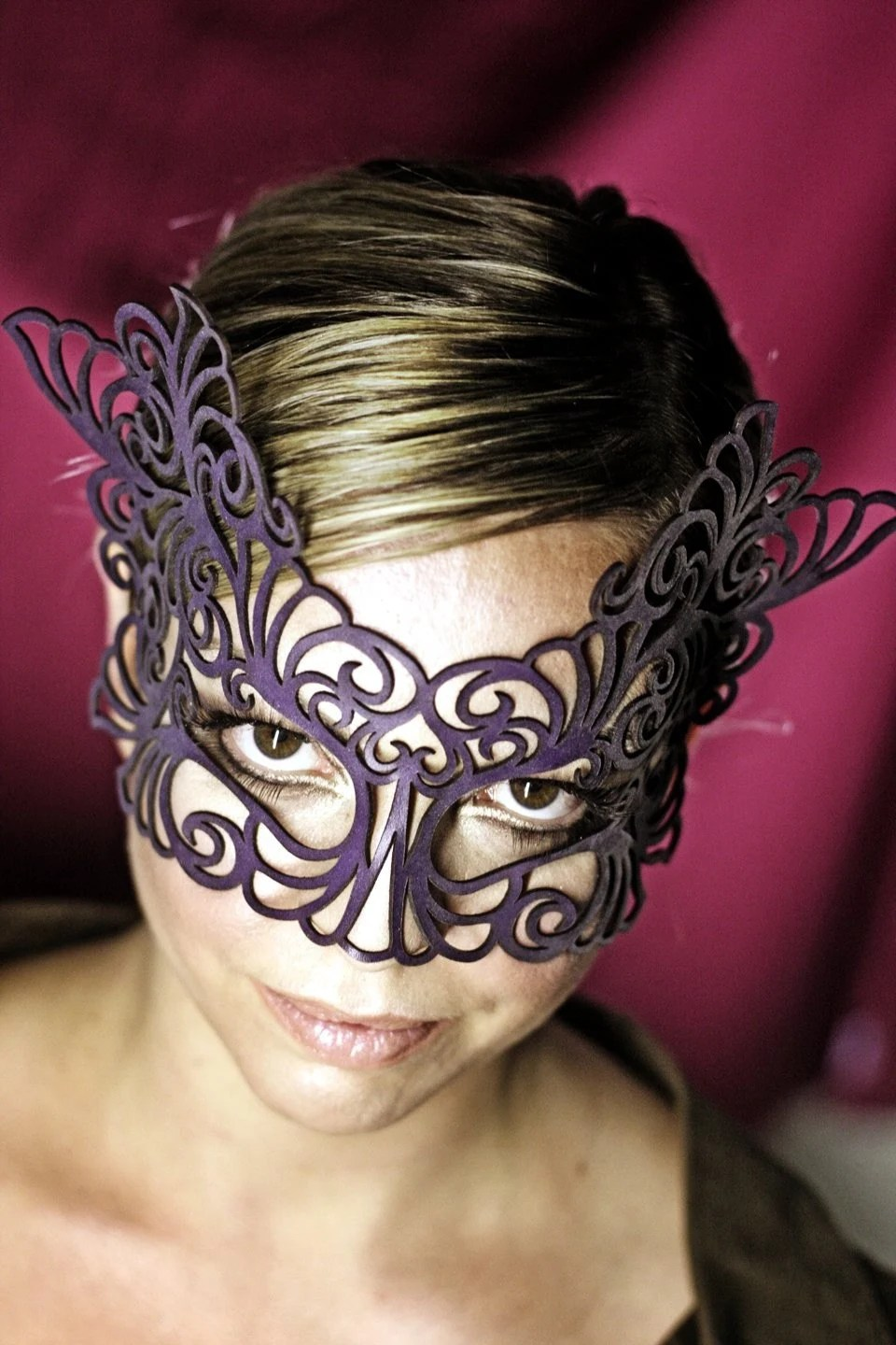 Rococo lacy mask in violet leather