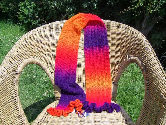 hand knitted bright frilly scarf in zauberball yarn
