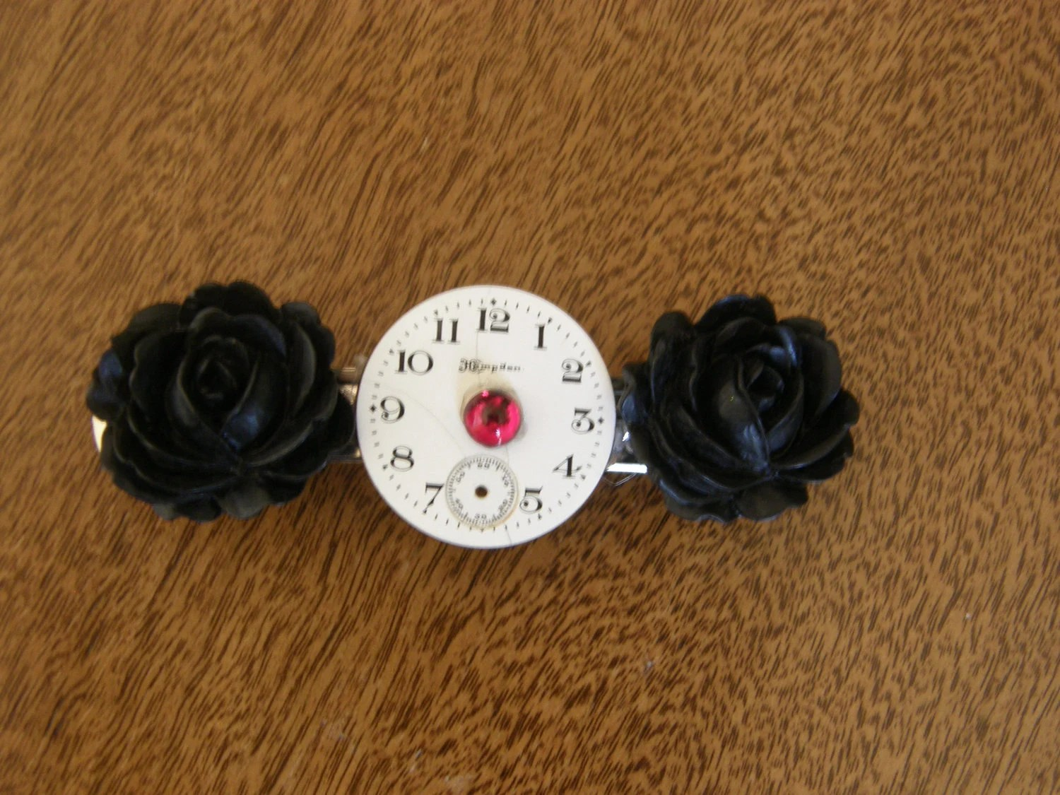 antique watch dial and black rose barrette