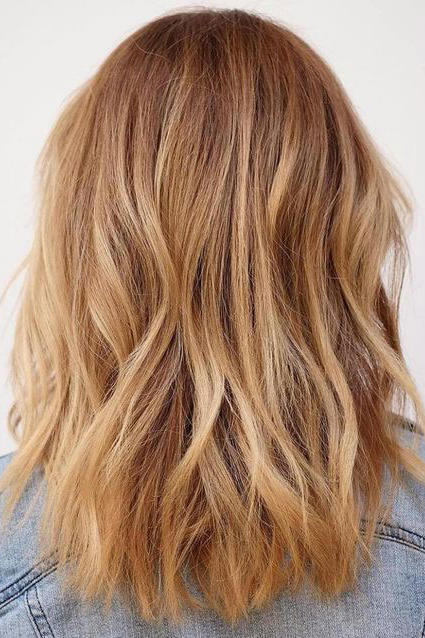 Strawberry blonde with light balayage also warm hair shades perfect for brightening your locks this rh southernliving