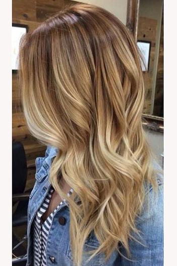 Honey blonde warm sandy also hair shades perfect for brightening your locks this spring rh southernliving