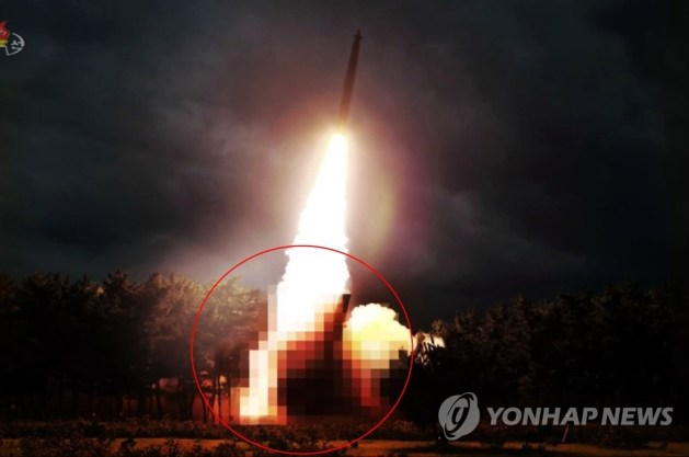 This photo captured from Pyongyang's state TV on Aug. 1, 2019, shows the test-firing of what North Korea claims to be a newly developed large-caliber multiple launch guided rocket system with the launcher part blurred out. (For Use Only in the Republic of Korea. No Redistribution) (Yonhap)