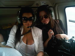 Kim Kardashian shows great cleavage aboard helicopter - Hot Celebs Home