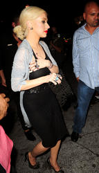 Christina Aguilera in black (sheer?) dress out and about in Miami - Hot Celebs Home