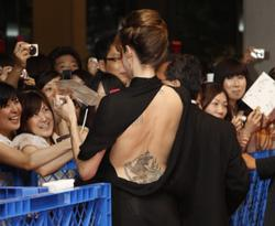 Angelina Jolie in sheer black dress showing her ass at the Salt premiere in Tokyo - Hot Celebs Home
