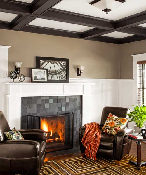 living room of remodeled Craftsman with slate-tile surround and wood mantel
