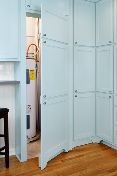 open kitchen after remodel with fake cabinet doors to hide storage area for water heater