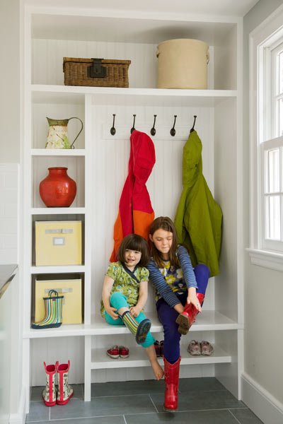 kids in mudroom with storage and clothing hooks, ask this old house tv producer chris wolfe remodeled kitchen