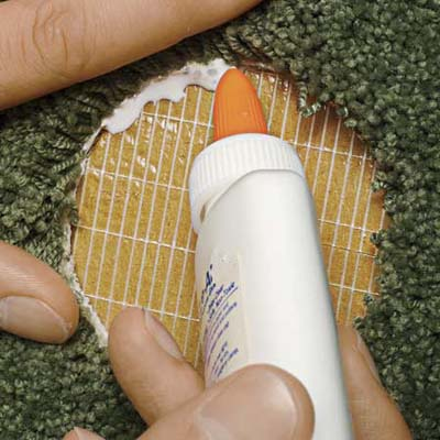 Place a narrow bead of carpet-seam glue along the perimeter of the cutout.
