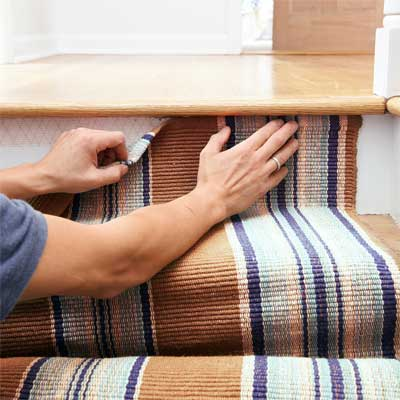 Tape the Runner to the Top Riser to Install a Flat-Weave Cotton Stair Runner