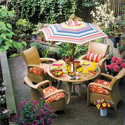 outdoor table under striped umbrella