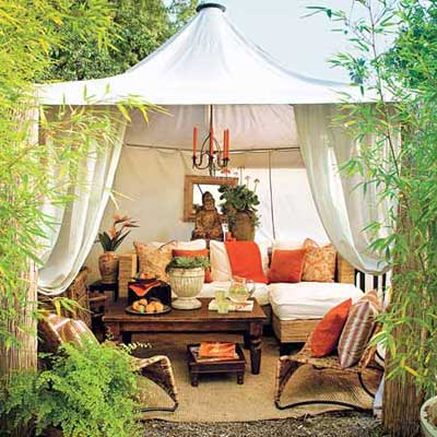 outdoor dining area under tented cabana