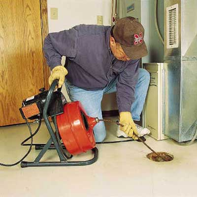 Clear a Floor Drain Using a Power Auger  How to Clear Any Clogged Drain  This Old House