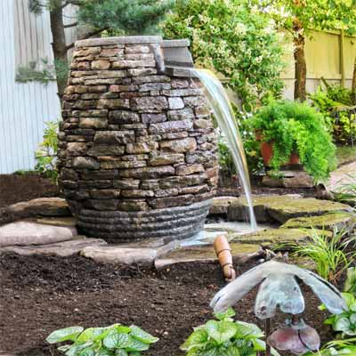Garden Fountains Ideas tour a welcoming front yard deck diy fountainfountain designoutdoor Ideas For Garden Fountains