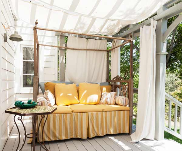upgrade outdoor room, canvas tarp as awning suspended on pergola, day bed and side table