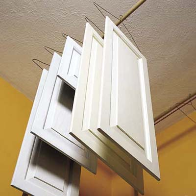 cabinet doors hanging to dry