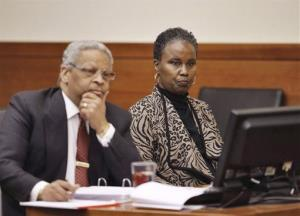 Sheila Kearns, right, listens to testimony in Judge Schneider's courtroom with attorney Geoffrey Oglesby on Jan. 13, 2015.