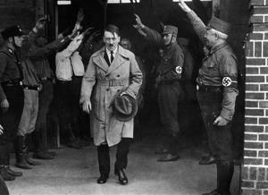 In this Dec. 5, 1931 file photo, Adolf Hitler is saluted as he leaves his party's Munich headquarters.