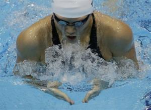 China's Ye Shiwen swims in her semifinal of the women's 200-meter individual medley at the Aquatics Centre in the Olympic Park during the 2012 Summer Olympics in London, Monday, July 30, 2012.