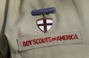 This photo taken Monday, Feb. 4, 2013, shows a close up detail of a Boy Scout uniform worn by Brad Hankins, a campaign director for Scouts for Equality.