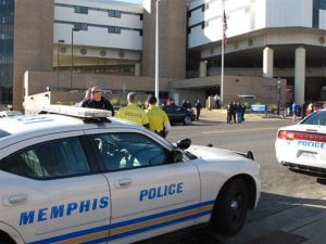 Memphis Police Department officers gather outside the Regional Medical Center after two of their fellow officers were involved in a shooting in 2002.