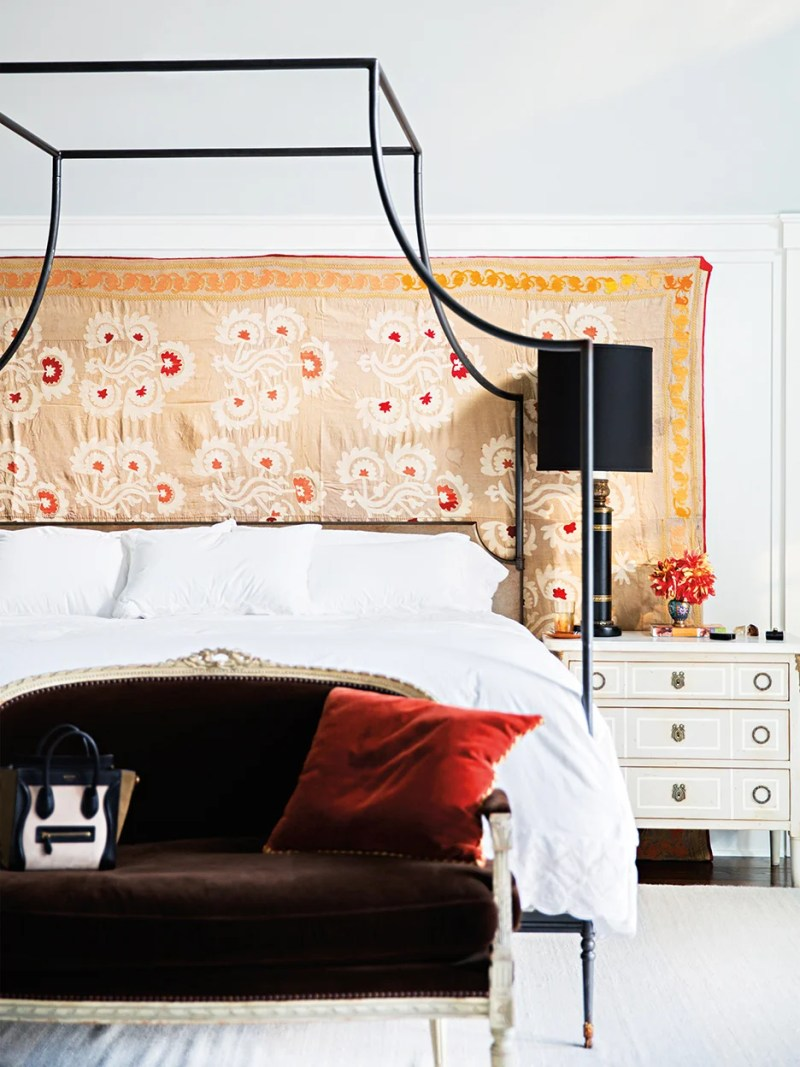 a bedroom with a tapestry