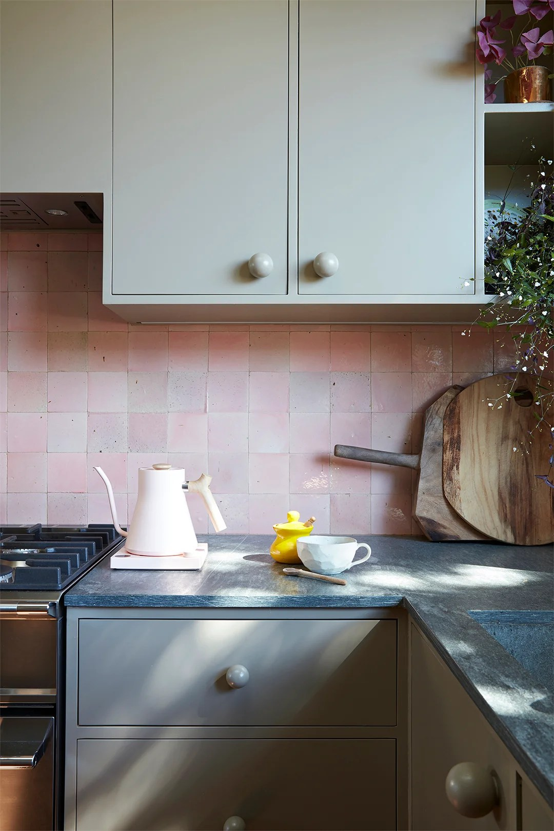 pink square backsplash and gray cupboards