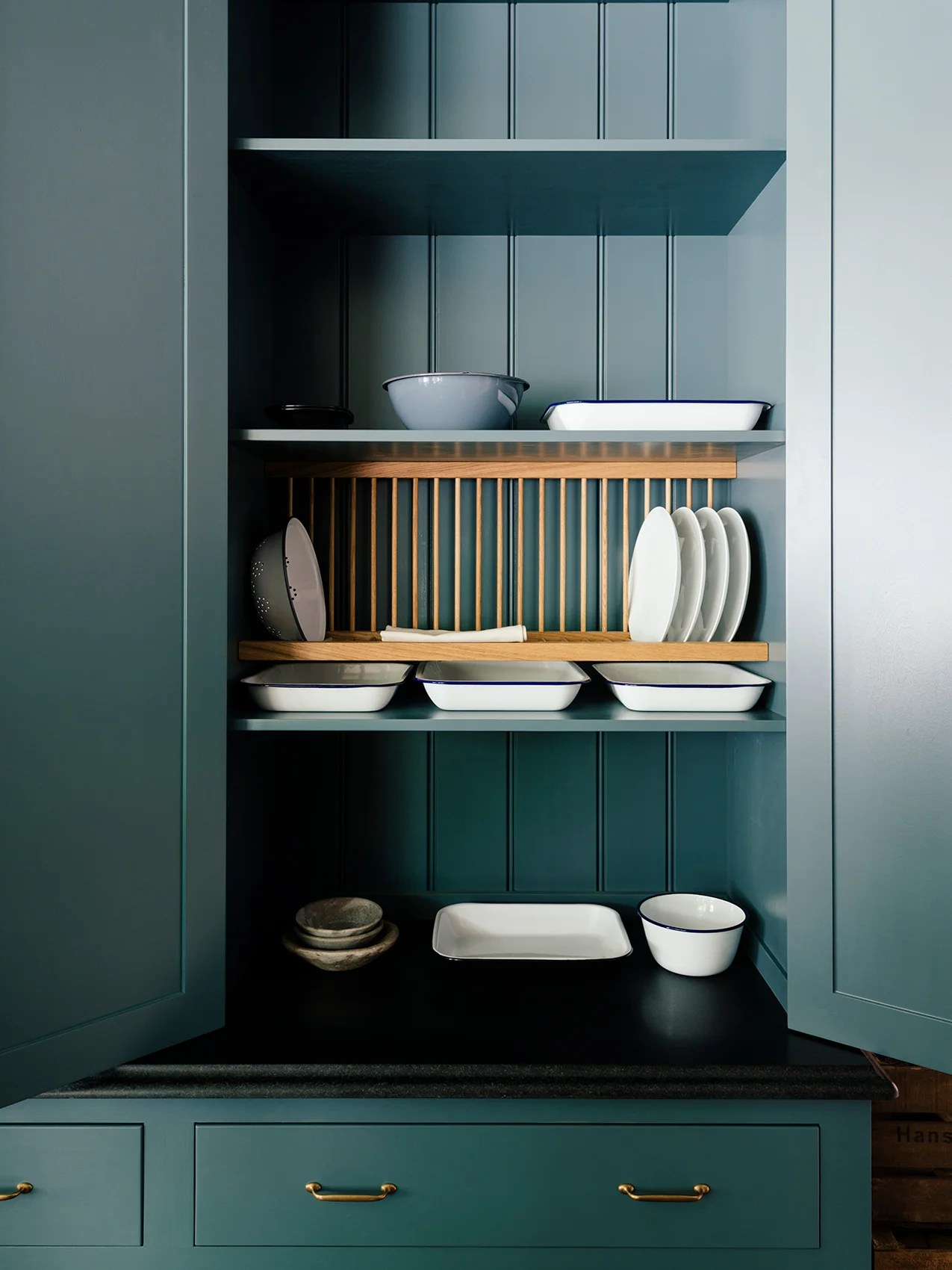 plate rack will take the open shelving