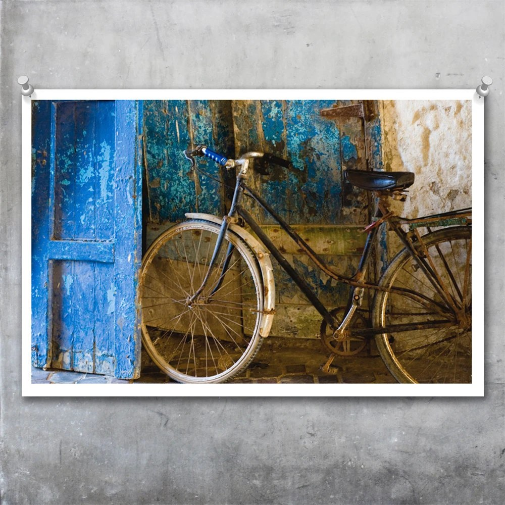Blue Bicycle against grungy and textured old door and wall in Morocco poster print photgraph wall art - 20x30 image with white border - EyeshootPhotography