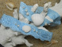 Items similar to Beach wedding garter set with real ...