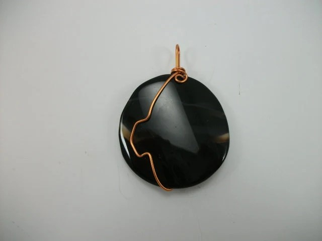 Jewelry...your way.  A large, wavy Agate pendant with copper bail/wrap.  Finish it yourself and save.