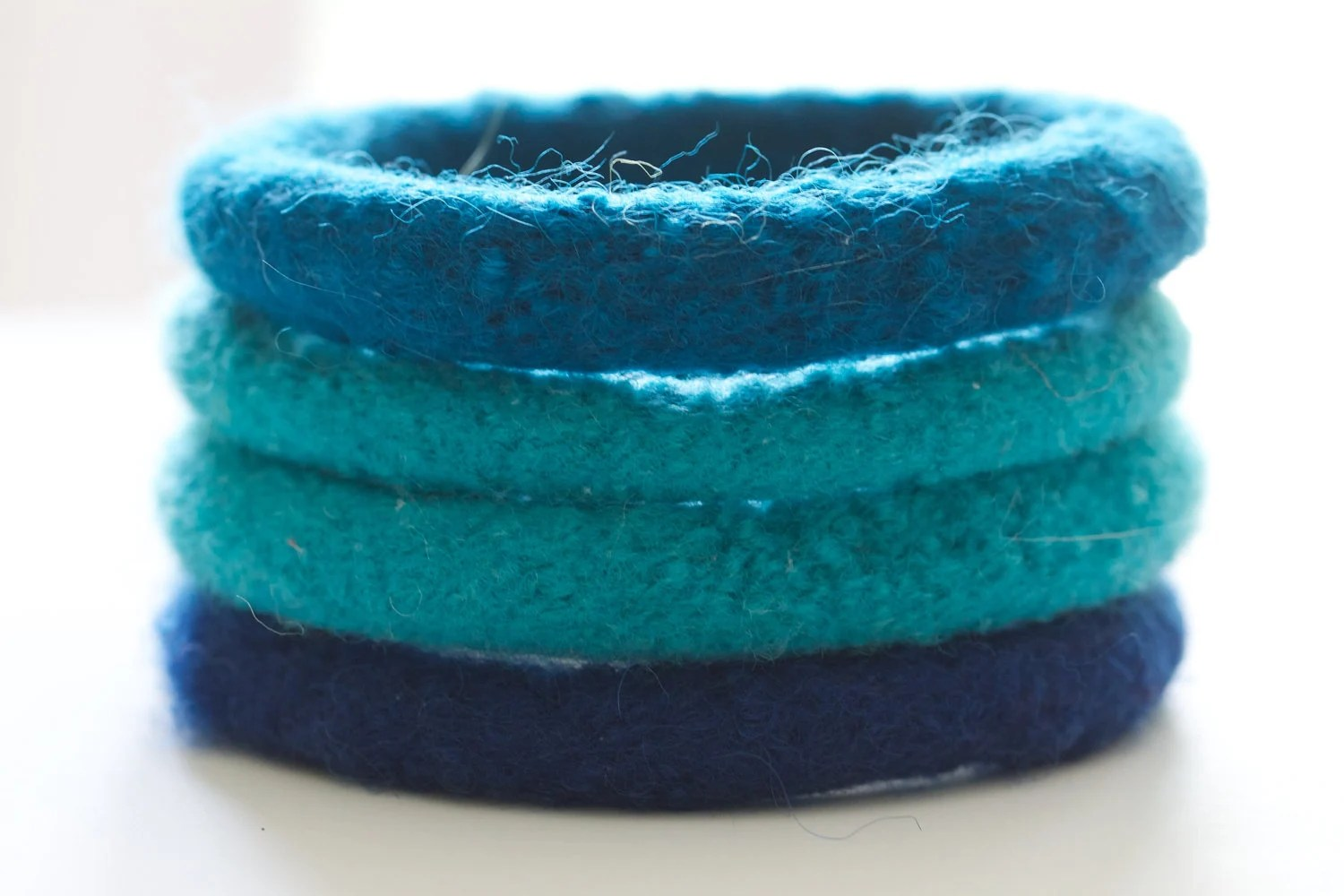 Felted wool bangles in ocean blues
