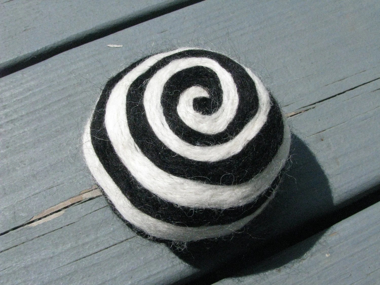 One multi-colored felted pin-cushion, Black and White - Dreamcrafter