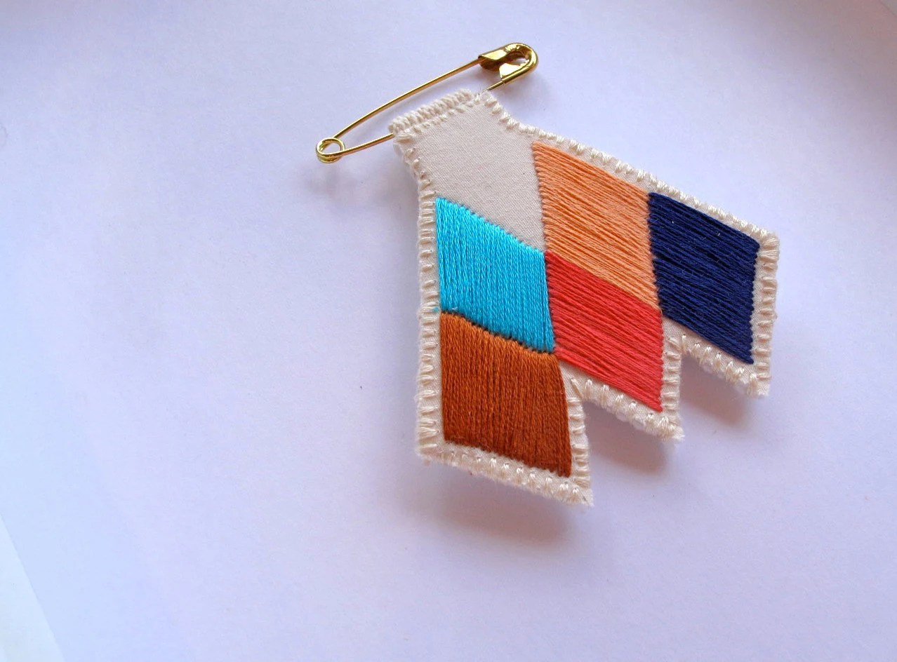 Chevron diamond badge embroidered coral blue peach tan brooch Tuareg inspired