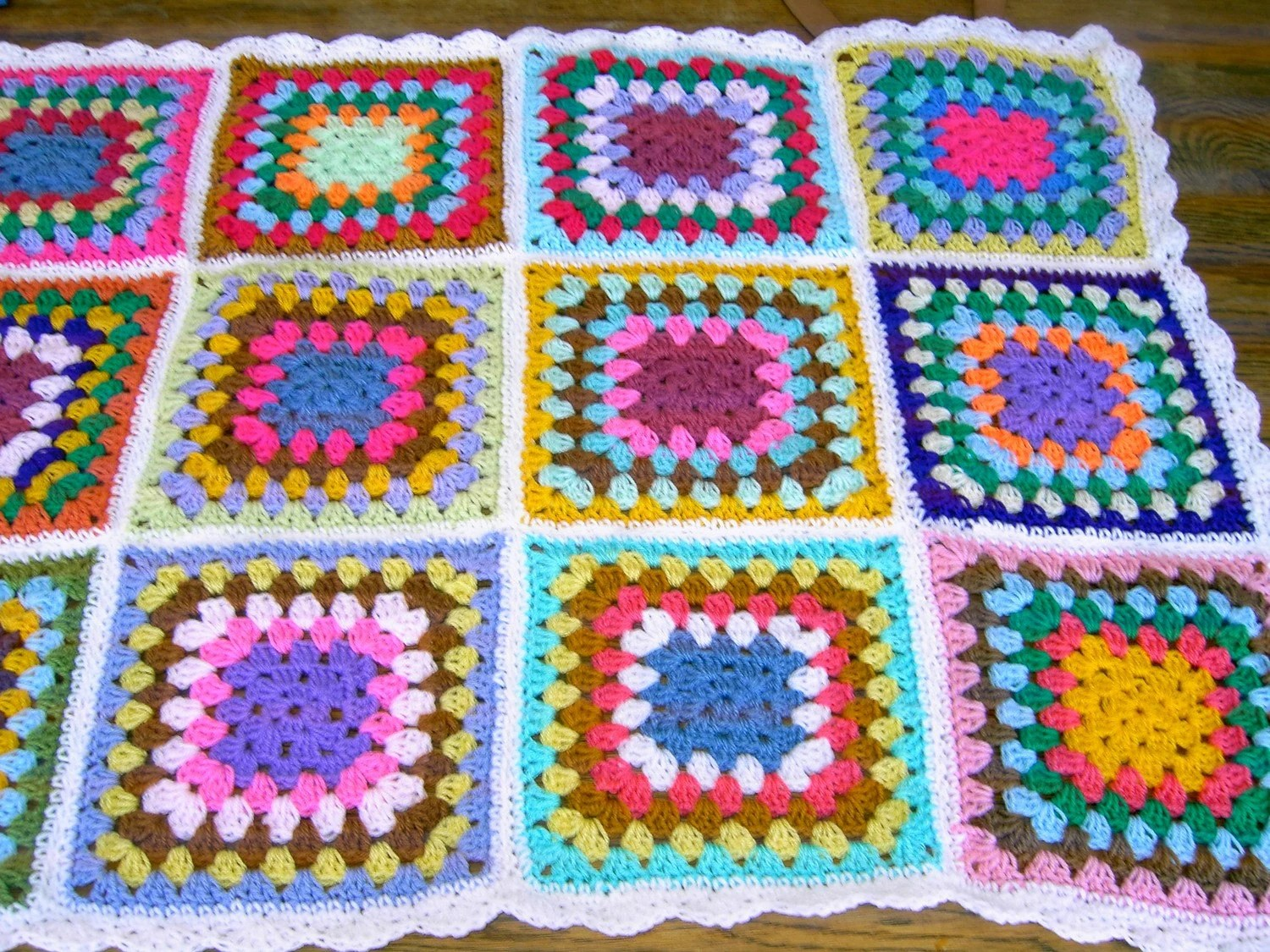 Handmade crochet blanket -  Made in tradition granny multi colour style with white border CUDDLE BLANKET ( nannycheryl original )  669