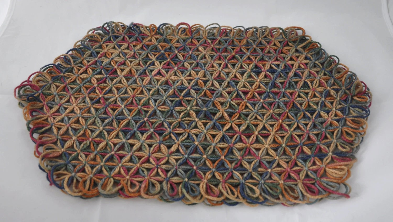 Large Trivet in 3 Layers of Painted Desert Multicolored Yarn with Painted Desert Ties - Fall Autumn Colors