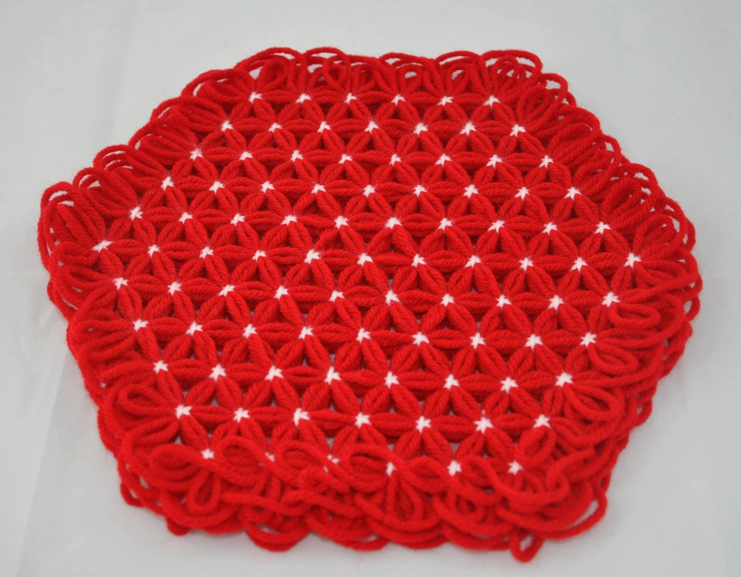 Small Trivet in 4 Layers of Bright Red Yarn with White Ties